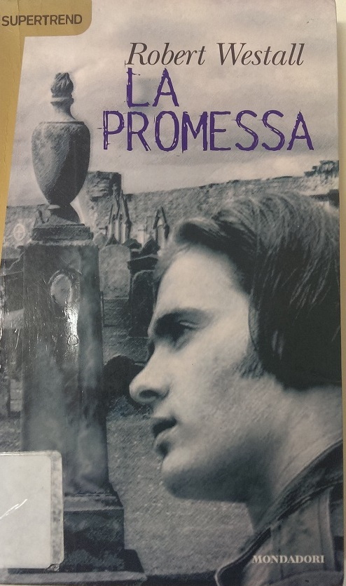 Copertina del libro con l'immagine di un ragazzo in primo piano ripreso di profilo
