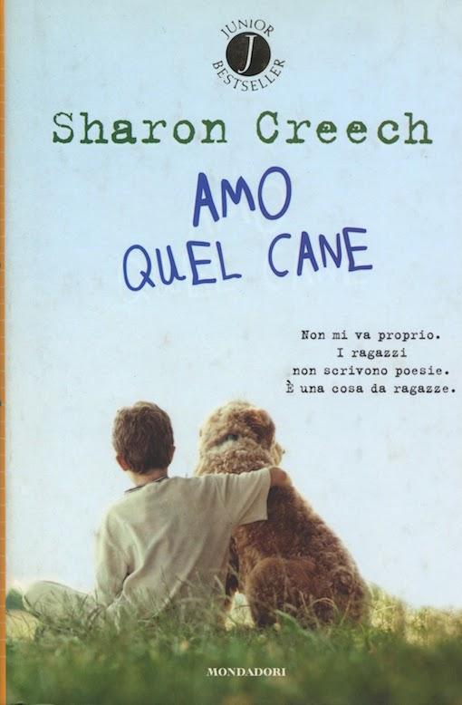 Copertina del libro con l'immagine di un bambino che abbraccia un cane ripresi di spalle