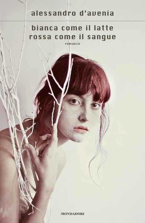 Copertina del libro con l'immagine di una ragazza dai capelli rossi