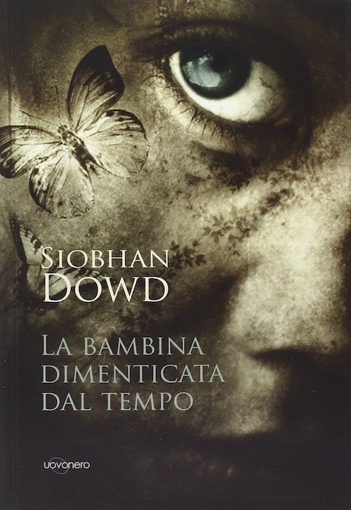 copertina del libro con un viso di bambina in primo piano con un occhio verde e una farfalla