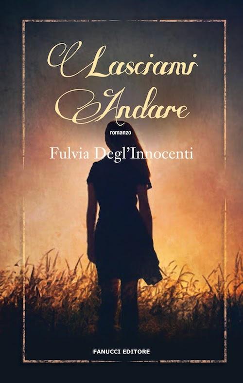 copertina del libro mostra una ragazza al tramonto in un campo di grano
