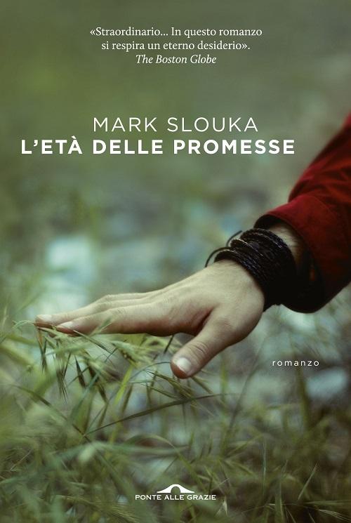 Copertina del libro con la fotografia di una mano che accarezza l'erba